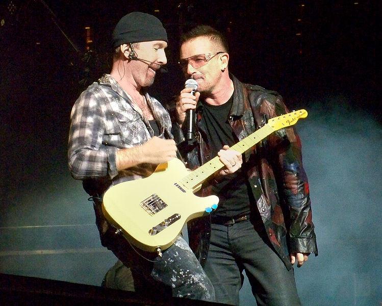 Bono and The Edge of U2 at Gillette Stadium, Foxboro, MA 9/21/2009. Photo via Wikipedia Commons by xrayspx